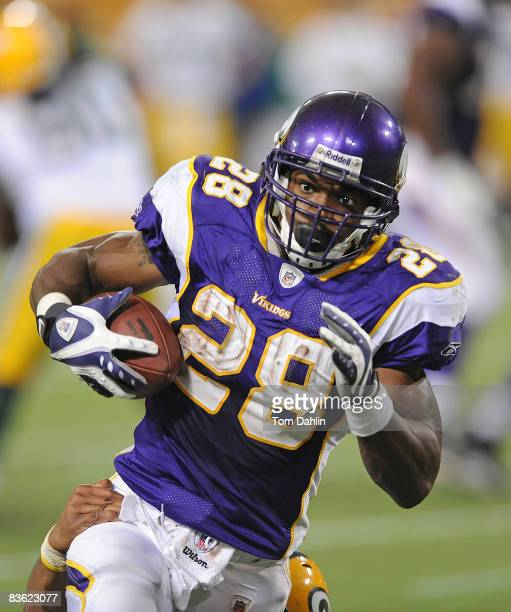 Adrian Peterson of the Minnesota Vikings carries the ball during an NFL game against the Green Bay Packers at the Hubert H Humphrey Metrodome on...