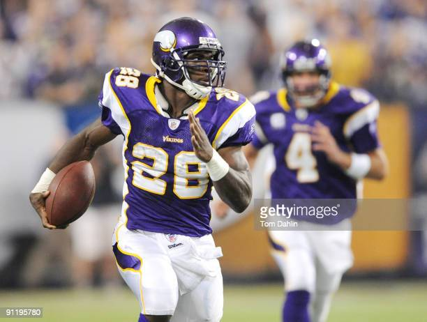 Adrian Peterson of the Minnesota Vikings carries the ball during an NFL game against the San Francisco 49ers at the Hubert H. Humphrey Metrodome, on...