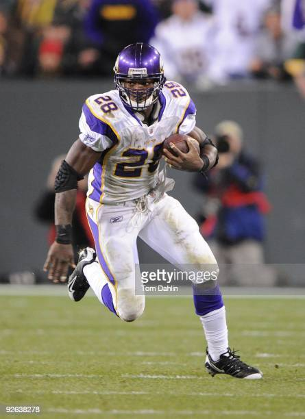 Adrian Peterson of the Minnesota Vikings carries the ball during an NFL game against the Green Bay Packers at Lambeau Field on November 1 2009 in...