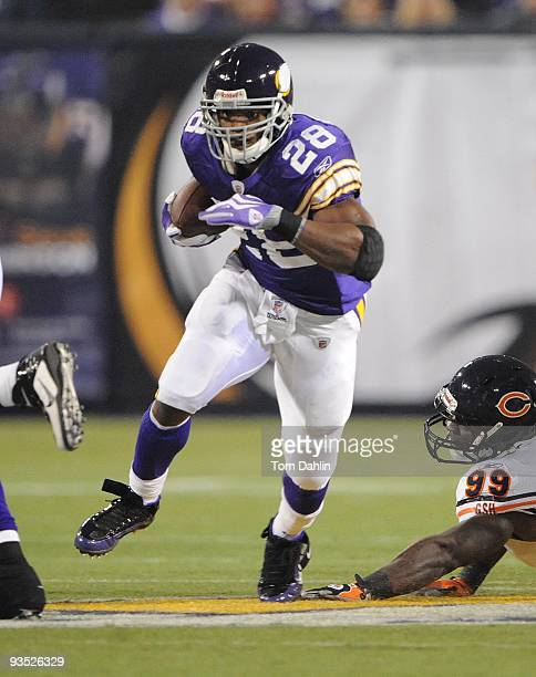 Adrian Peterson of the Minnesota Vikings carries the ball during an NFL game against the Chicago Bears at the Mall of America Field at Hubert H...