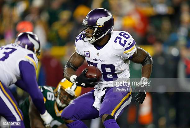 Adrian Peterson of the Minnesota Vikings carries the ball during the first quarter against the Green Bay Packers at Lambeau Field on January 3 2016...