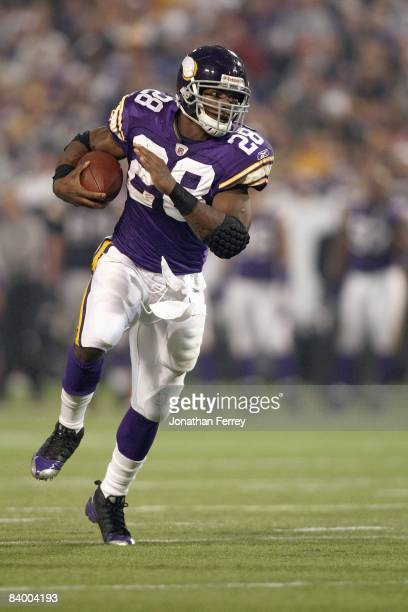 Adrian Peterson of the Minnesota Vikings carries the ball during the game against the Chicago Bears at the Metrodome on November 30 2008 in...
