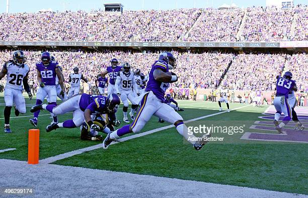 Adrian Peterson of the Minnesota Vikings carries the ball for a touchdown in the first quarter against the St Louis Rams on November 8 2015 at TCF...