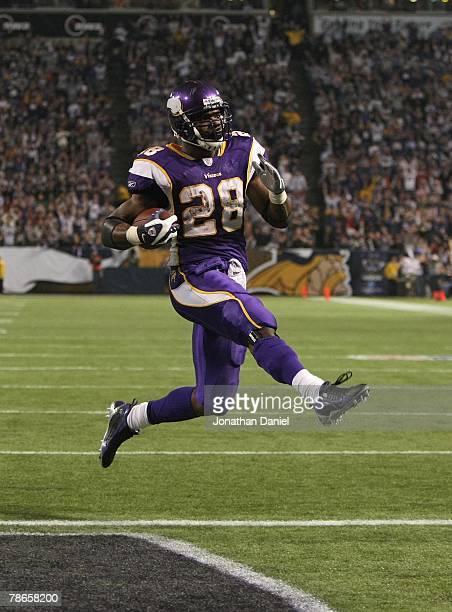 Adrian Peterson of the Minnesota Vikings carries the ball for a touchdown against the Chicago Bears at the Hubert H Humphrey Metrodome on December 17...