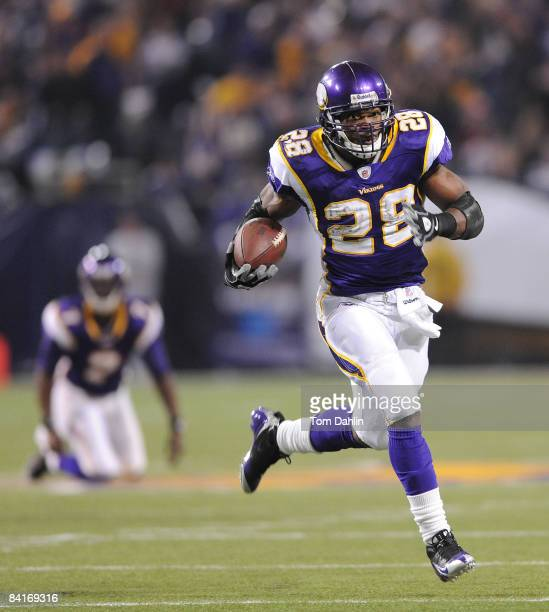 Adrian Peterson of the Minnesota Vikings carries the ball on his way to a touchdown during the NFC Wild Card playoff game against the Philadelphia...
