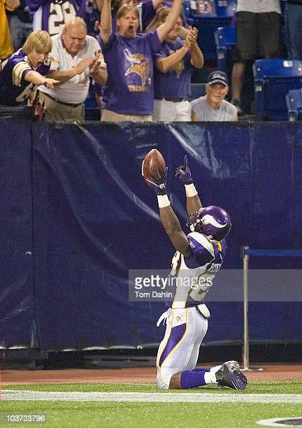 Adrian Peterson of the Minnesota Vikings celebrates a touchdown during an NFL preseason game against the Seattle Seahawks at the Mall of America...