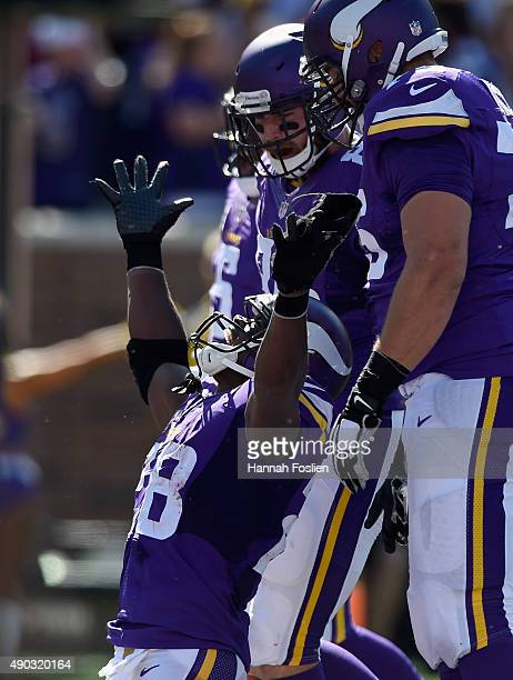 Adrian Peterson of the Minnesota Vikings celebrates scoring a touchdown against the San Diego Chargers during the second quarter of the game on...