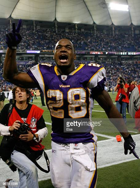 Adrian Peterson of the Minnesota Vikings celebrates their 343 victory over the Dallas Cowboys during the NFC Divisional Playoff Game at Hubert H...