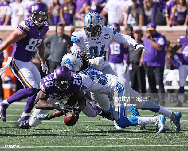Adrian Peterson of the Minnesota Vikings fumbles the ball after being hit by Rashean Mathis of the Detroit Lions at TCF Bank Stadium on September 20,...