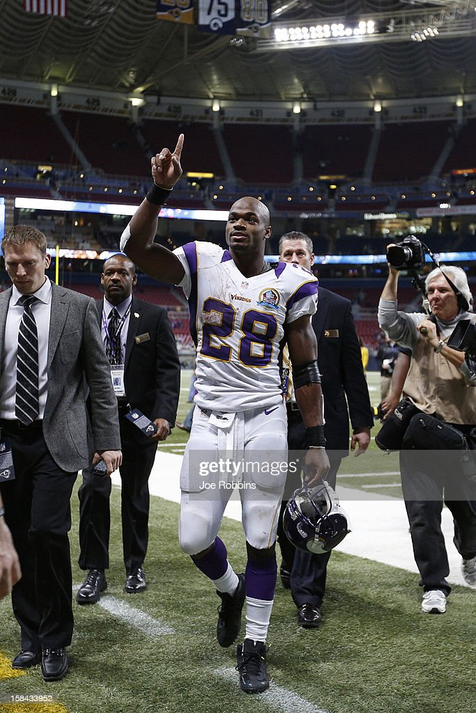 Adrian Peterson #28 of the Minnesota Vikings gestures toward fans after the game against the St. Louis Rams at Edward Jones Dome on December 16, 2012 in St. Louis, Missouri. The Vikings won 36-22 as Peterson rushed for 212 yards.