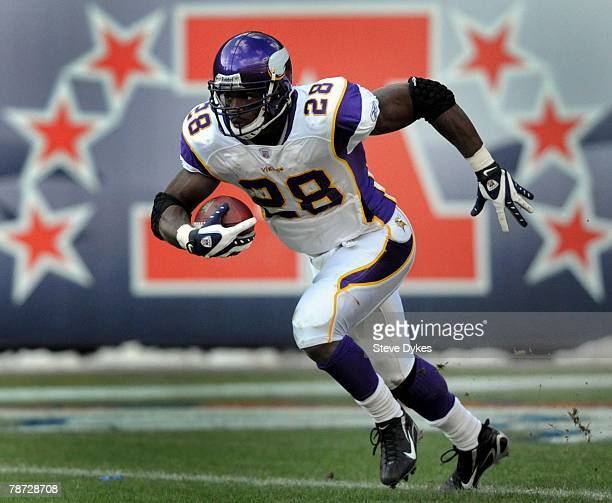 Adrian Peterson of the Minnesota Vikings heads upfield as he returns a kickoff during the football game against the Denver Broncos at Invesco Field...