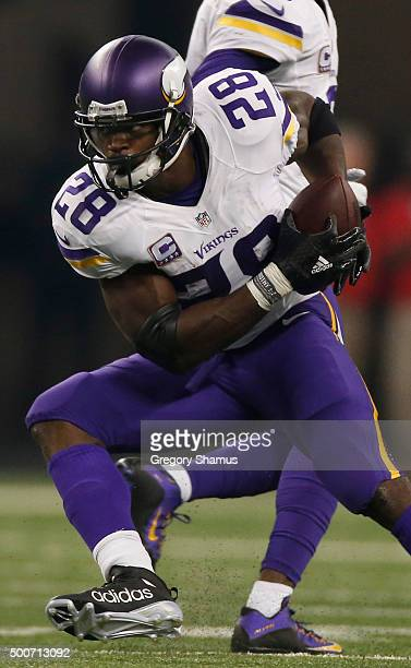 Adrian Peterson of the Minnesota Vikings looks to avoid the take by Josh Bynes of the Detroit Lions at Ford Field on October 25, 2015 in Detroit,...