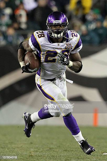 Adrian Peterson of the Minnesota Vikings runs against the Philadelphia Eagles at Lincoln Financial Field on December 28 2010 in Philadelphia...