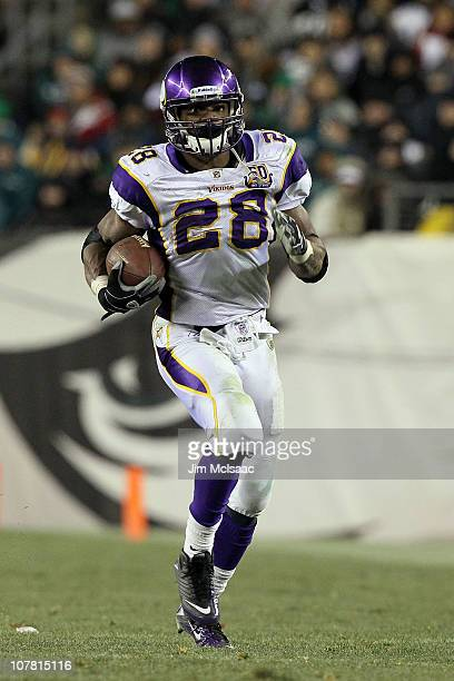 Adrian Peterson of the Minnesota Vikings runs against the Philadelphia Eagles at Lincoln Financial Field on December 26 2010 in Philadelphia...