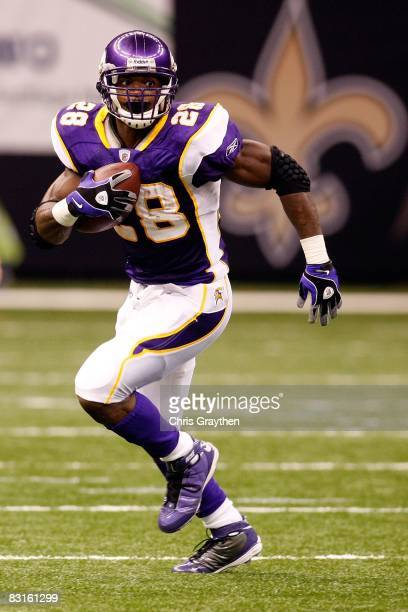 Adrian Peterson of the Minnesota Vikings runs against the New Orleans Saints on October 6 2008 at the Superdome in New Orleans Louisiana