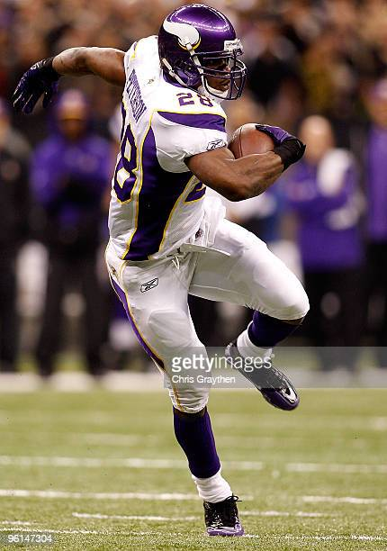Adrian Peterson of the Minnesota Vikings runs for a 19yard touchdown in the first quarter against the New Orleans Saints during the NFC Championship...