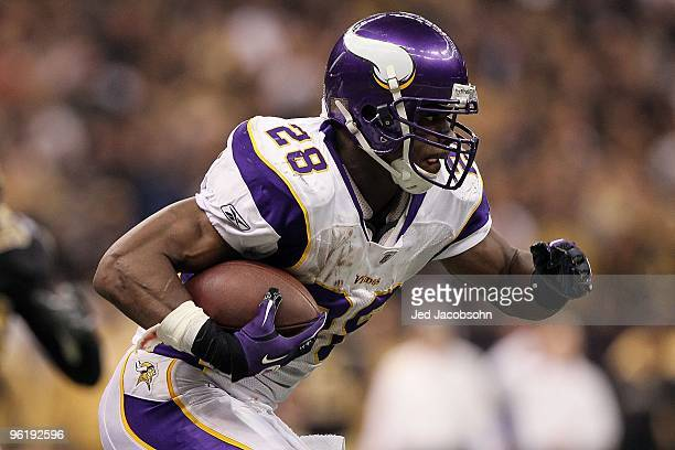 Adrian Peterson of the Minnesota Vikings runs the ball against the New Orleans Saints during the NFC Championship Game at the Louisiana Superdome on...