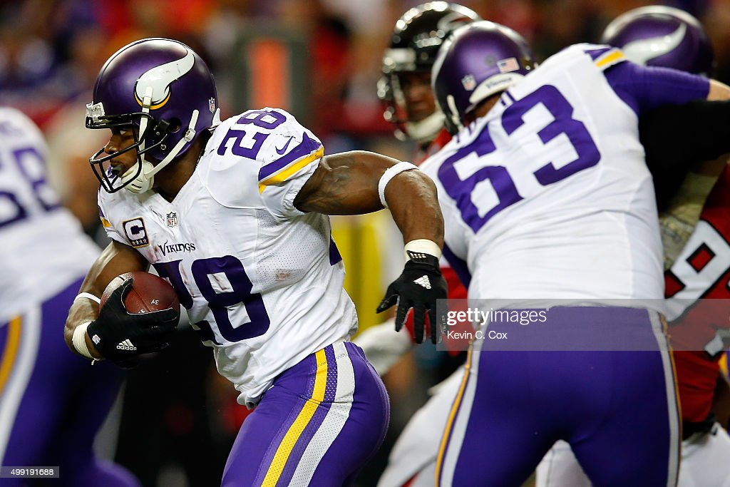 Adrian Peterson #28 of the Minnesota Vikings runs the ball during the second half against the Atlanta Falcons at the Georgia Dome on November 29, 2015 in Atlanta, Georgia.