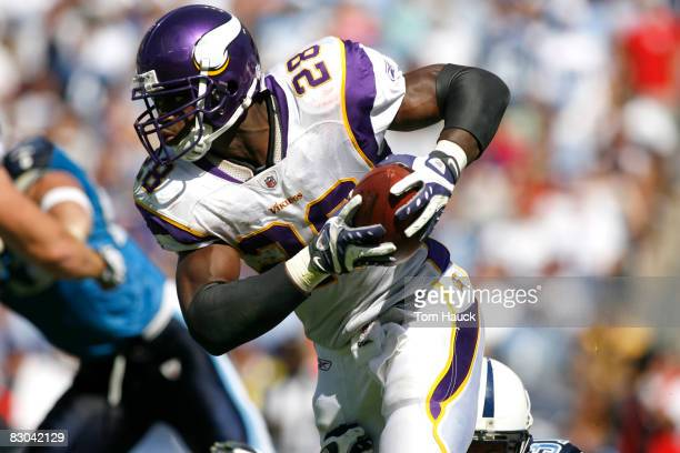 Adrian Peterson of the Minnesota Vikings runs with the ball against the Tennessee Titans at LP Field on September 28 2008 in Nashville Tennessee The...
