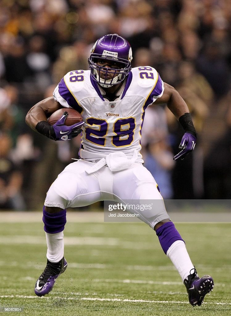 Adrian Peterson #28 of the Minnesota Vikings runs with the ball against the New Orleans Saints during the NFC Championship Game at the Louisiana Superdome on January 24, 2010 in New Orleans, Louisiana. The Saints won 31-28 in overtime.