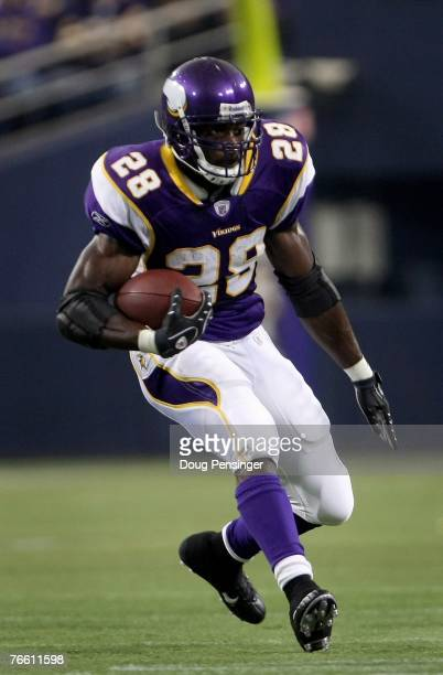 Adrian Peterson of the Minnesota Vikings rushes against the Atlanta Falcons during week one NFL action at the Metrodome on September 9 2007 in...