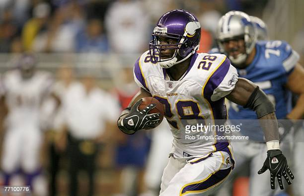 Adrian Peterson of the Minnesota Vikings rushes against the Detroit Lions against the Minnesota Vikings at Ford Field on September 16 2007 in Detroit...
