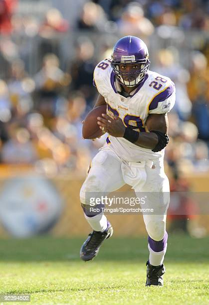 Adrian Peterson of the Minnesota Vikings rushes against the Pittsburgh Steelers at Heinz Field on October 25, 2009 in Pittsburgh, Pennsylvania. The...