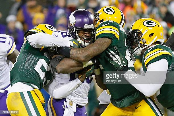 Adrian Peterson of the Minnesota Vikings scores a touchdown during the third quarter against the Green Bay Packers at Lambeau Field on January 3 2016...