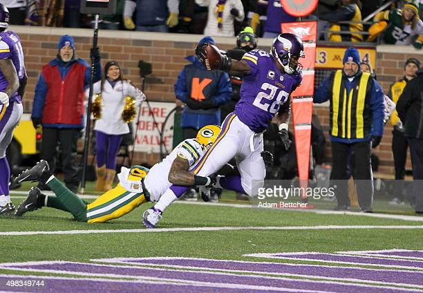 Adrian Peterson of the Minnesota Vikings scores a touchdown while Ha Ha ClintonDix of the Green Bay Packers attempts the tackle in the third quarter...