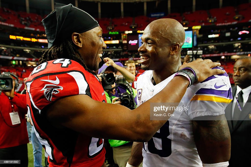 Adrian Peterson #28 of the Minnesota Vikings shakes hands with Roddy White #84 of the Atlanta Falcons after the game during the second half at the Georgia Dome on November 29, 2015 in Atlanta, Georgia.