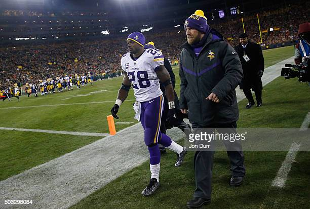 Adrian Peterson of the Minnesota Vikings walks off the field to the locker room during the third quarter against the Green Bay Packers at Lambeau...