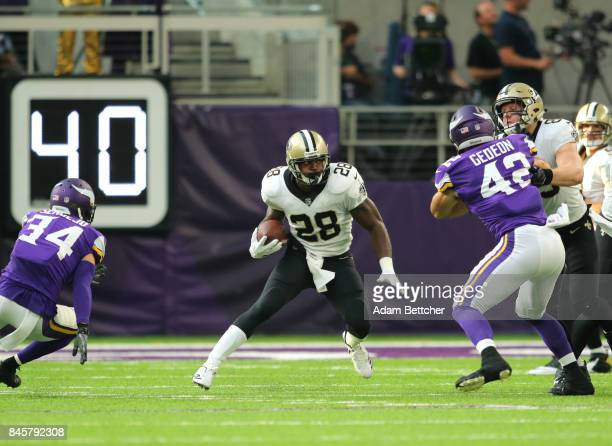 Adrian Peterson of the New Orleans Saints carries the ball in the first quarter of the game against the Minnesota Vikings on September 11 2017 at US...