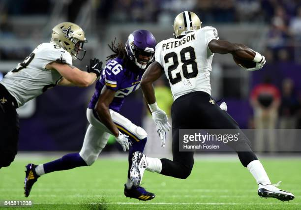 Adrian Peterson of the New Orleans Saints carries the ball in the first half of the game against the Minnesota Vikings on September 11 2017 at US...
