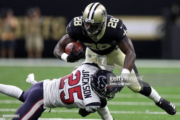 Adrian Peterson of the New Orleans Saints is tackled by Kareem Jackson of the Houston Texans at MercedesBenz Superdome on August 26 2017 in New...