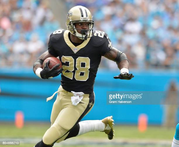 Adrian Peterson of the New Orleans Saints runs against the Carolina Panthers during their game at Bank of America Stadium on September 24 2017 in...