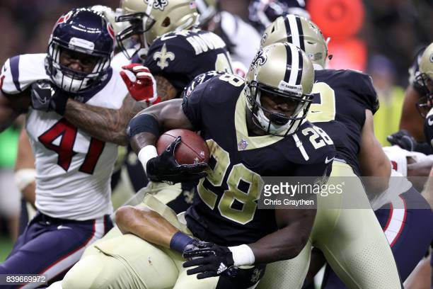 Adrian Peterson of the New Orleans Saints runs against the Houston Texans at MercedesBenz Superdome on August 26 2017 in New Orleans Louisiana