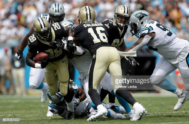 Adrian Peterson of the New Orleans Saints runs with the ball against the Carolina Panthers during their game at Bank of America Stadium on September...