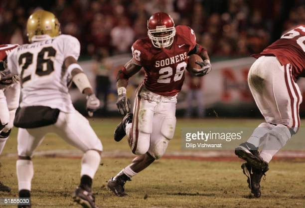 Adrian Peterson of the University of Oklahoma Sooners caries the ball against the University of Colorado Buffaloes in the Big 12 Championship game on...