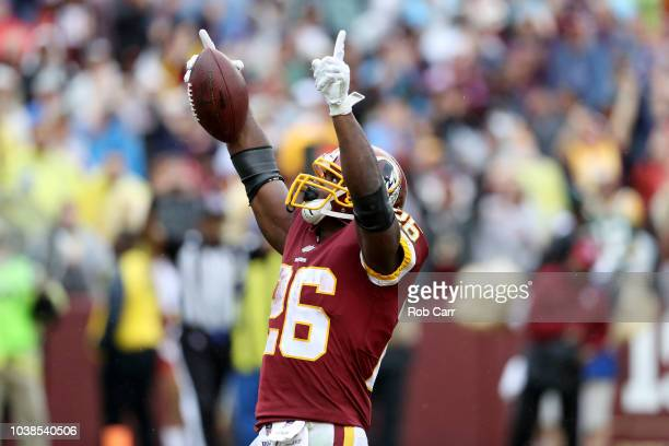Adrian Peterson of the Washington Redskins celebrates after rushing for a first half touchdown against the Green Bay Packers at FedExField on...