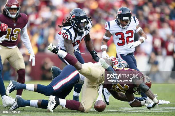 Adrian Peterson of the Washington Redskins fumbles the ball as he is tackled by Benardrick McKinney of the Houston Texans in the second quarter at...