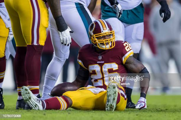 Adrian Peterson of the Washington Redskins looks on after being tackled by the Philadelphia Eagles during the first half at FedExField on December 30...