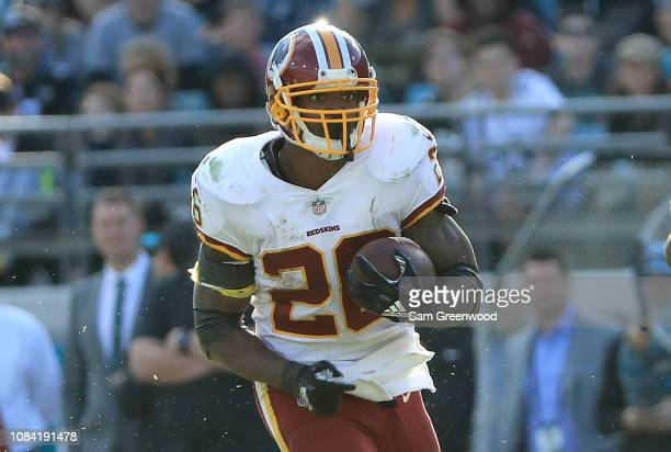 Adrian Peterson of the Washington Redskins runs for yardage during the game against the Jacksonville Jaguars at TIAA Bank Field on December 16 2018...