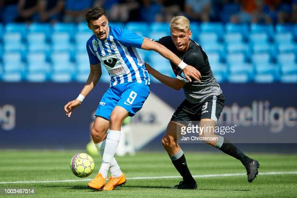 Adrian Petre of Esbjerg fB and Soren Henriksen of Vendsyssel FF compete for the ball during the Danish Superliga match between Esbjerg fB and...