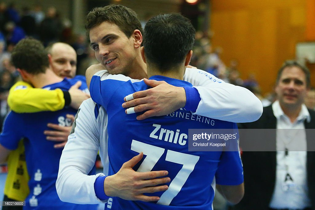 Adrian Pfahl embraces Verdran Zrnic of Gummersbach after winning 27-26 the DKB Handball Bundesliga match between VfL Gummersbach and FrischAuf Goeppingen at Eugen-Haas-Sporthalle on February 20, 2013 in Gummersbach, Germany.
