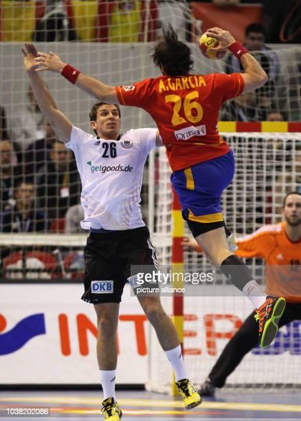 Adrian Pfahl of Germany blocks Antonio Garcia Robledo of Spain during the men's Handball World Championships quarterfinal match Spain vs Germany in...