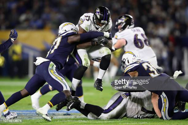 Adrian Phillips Jatavis Brown of the Los Angeles Chargers tackle Gus Edwards of the Baltimore Ravens during the first half of a game at StubHub...