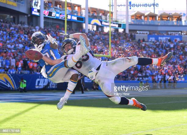 Adrian Phillips of the Los Angeles Chargers attempts an interception on a pass to AJ Derby of the Denver Broncos during the third quarter at StubHub...