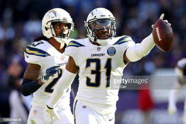 Adrian Phillips of the Los Angeles Chargers celebrates after intercepting a pass by Lamar Jackson of the Baltimore Ravens during the second quarter...