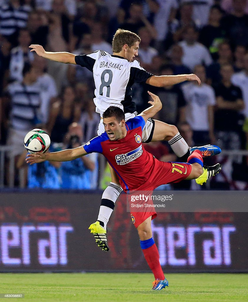 Adrian Popa (R) of FC Steaua Bucharest jump for the ball against Darko Brasanac (L) of FC Partizan Belgrade during the UEFA Champions League Third Qualifying Round Second Leg match between FC Partizan Belgrade and FC Steaua Bucharest at FC Partizan stadium in Belgrade, Serbia on Wednesday, August 05, 2015.