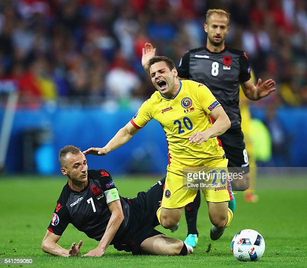 Adrian Popa of Romania is tackled by Ansi Agolli of Albania during the UEFA EURO 2016 Group A match between Romania and Albania at Stade des Lumieres...